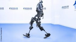 Photo: Exoskeleton in front of white blue background; Copyright: Kessler Foundation