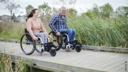 Photo: wheelchair users on a pier wearing adaptive outdoor clothes; Copyright: So Yes