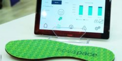 Photo: Sensory insole by novapace lying in front of a tablet on a table; Copyright: novapace