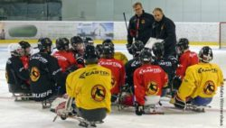 Photo: The German Para Ice Hockey National Team is listening to their coach Andreas Pokorny; Copyright: Malte Wittmershaus