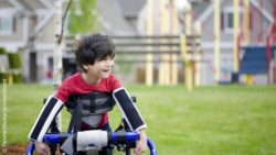 Image: Child with cerebral palsy with a walking aid; Copyright: PantherMedia/jarenwicklund
