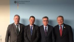 Photo: Andrew Parsons with officials from the German Ministry of Interior; Copyright: IPC