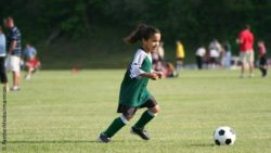 Photo: Young girl playing soccer; Copyright: PantherMedia/rmarmion