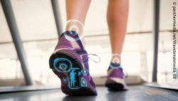 Photo: A woman's legs walking on a treadmill. There are digital inserts on the ankles and the sole of the foot; Copyright: panthermedia.net/Wavebreakmedia ltd