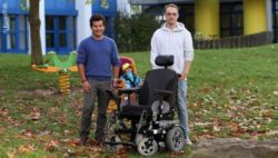 Photo: Michael Weber (left) and Johannes Imhoff presenting the child seat for wheelchairs; Copyright: Koziel/TUK