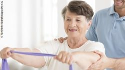 Photo: Elderly woman exercising, assisted by an accredited exercise physiologist; Copyright: PantherMedia/photographee.eu