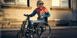 Photo: Wheelchair user with Triride power attachment; Copyright: Th10. Lukas and Anouk Kapfer / Triride.de
