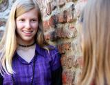 Photo: Teenage girl talking to another girl