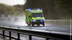Photo: An ambulance with flashing blue lights driving on the freeway; Copyright: panthermedia.net/BrianAJackson