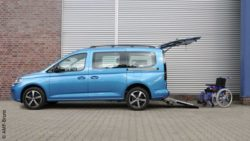Photo: new VW Caddy 5 with open tailgate and wheelchair next to it; Copyright: AMF-Bruns