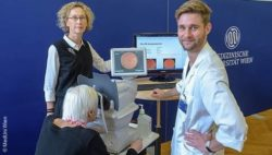 Photo: Ursula Schmidt-Erfurth and Kostiantyn Lupyr with a patient; Copyright: MedUni Vienna