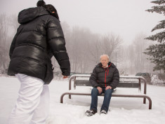 Photo: Man on a park bench