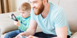 Photo: A boy playing video games with his father; Copyright: panthermedia.net/vadymvdrobot