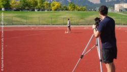 Photo: A man measuring the performance of a Paralympic track sprinter; Copyright: Applied Biomechanics Lab, University of Colorado