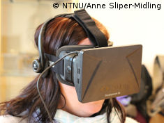 Photo: Woman wearing Oculus Rift headset