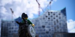 Photo: A Lego wheelchair figure in front of the Hamburg Elbphilharmonie; Copyright: Andi Weiland | Gesellschaftsbilder.de