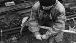 Photo: Black and white picture of an old mineworker; Copyright: panthermedia.net/Tinatin1