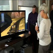 Photo: Patient with Parkinson's plays computer-game