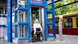 Photo: Woman in a wheelchair using an elevator