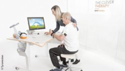 Photo: Older man during a rehabilitation unit with the Tyromotion system; Copyright: Tyromotion
