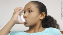 Photo: Young girl with astma uses an inhaler; Copyright: panthermedia.net/Craig Robinson