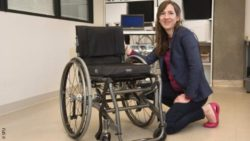 Photo: SFU researcher Victoria Claydon next to a wheelchair; Copyright: SFU
