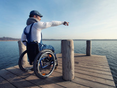 Photo: Man in a wheelchair at a lake