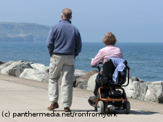 Photo: Man and woman with wheelchair