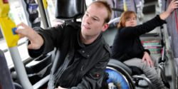 Photo: Female and male wheelchair users in a bus; Copyright: Josefsheim Bigge/Pedro Citoler