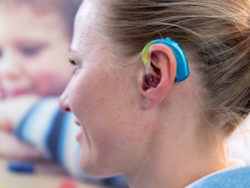 Photo: Close-up of a woman wearing a hearing aid