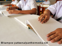 Photo: Students reading books in Braille