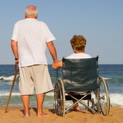 Photo: Man and woman in wheelchair on the beach