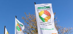 Photo: REHACARE flags in front of the fair halls; Copyright: Messe Düsseldorf/ctillmann