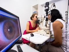 Photo: An optometrist conducting an eye examination