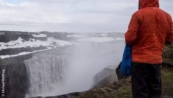 Photo: Person looking at the Dettifoss waterfall in Iceland; Copyright: Michael Rohlfing
