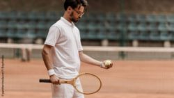 Photo: Man on the tennis court; Copyright: panthermedia.net/Y-Boychenko