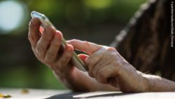 Photo: Elderly woman holding a smartphone in her hands; Copyright: panthermedia.net/Giulio_Fornasar