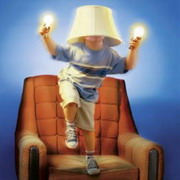 Photo: Boy wearing lights and lampshade on a chair