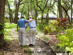 Photo: Dementia patient and family member walking in a park