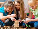 Photo: Three girls playing with toys