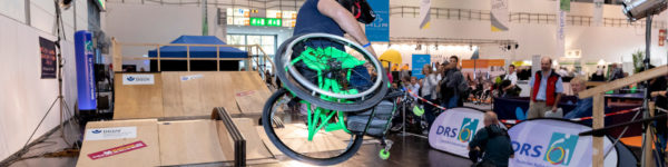 Photo: Aaron Fotheringham skating with his wheelchair in the skate park at REHACARE