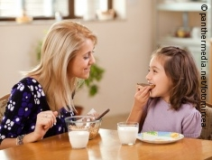 Photo: Mother and daughter having breakfast