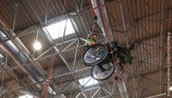 "Photo: Wheelchair user in a ""rope course"" at REHACARE 2016; Copyright: Messe Düsseldorf, Constanze Tillmann"