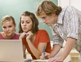 Photo: Teens in front of a laptop