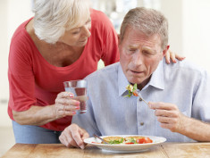Photo: Elderly man being reminded to eat
