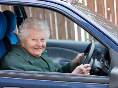 Photo: Elderly woman driving a car