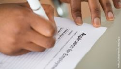 Photo: Person filling out an application form for employment; Copyright: PantherMedia/Andriy Popov