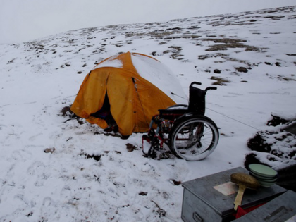 Photo: Tent and wheelchair in the snow