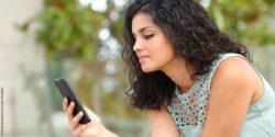 Photo: Young woman using her smartphone; Copyright: PantherMedia / Antonio Guillen Fernández