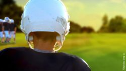 Image: a person in a blue shirt and a white helmet from behind; Copyright: Ben Hershey